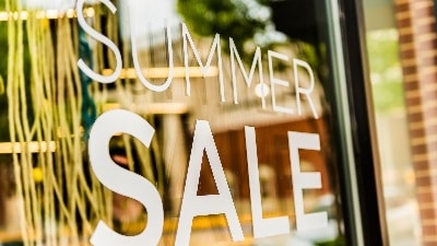 retail storefront window summer sale click and mortar online shopping